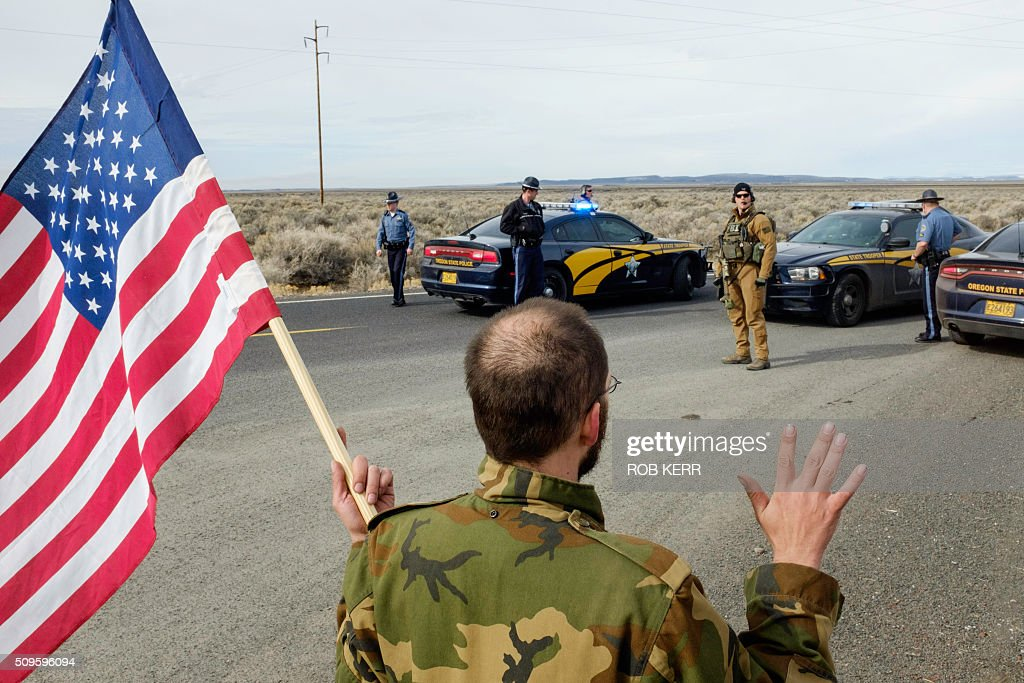 Tom Wagner, a self-described supporter of the movement agains the federal government, approaches the FBI and Oregon State Police near the Malheur Wildlife Refuge Headquarters near Burns, Oregon, on February 11, 2016. The FBI surrounded the last protesters holed up at a federal wildlife refuge in Oregon amid reports they will surrender on Thursday, suggesting the weeks-long armed siege is approaching a climax. / AFP / Rob Kerr