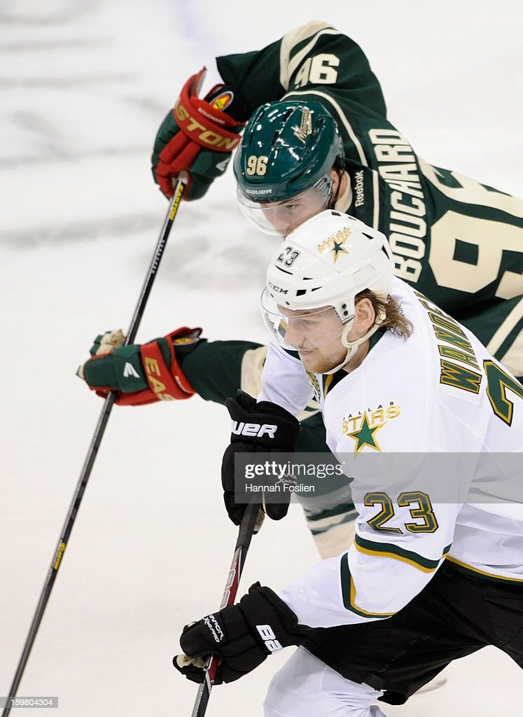 <a gi-track='captionPersonalityLinkClicked' href=/galleries/search?phrase=Tom+Wandell&family=editorial&specificpeople=4537393 ng-click='$event.stopPropagation()'>Tom Wandell</a> #23 of the Dallas Stars and Pierre-Marc Bouchard #96 of the Minnesota Wild skate after a puck during the first period of the game on January 20, 2013 at Xcel Energy Center in St Paul, Minnesota. The Wild defeated the Stars 1-0.