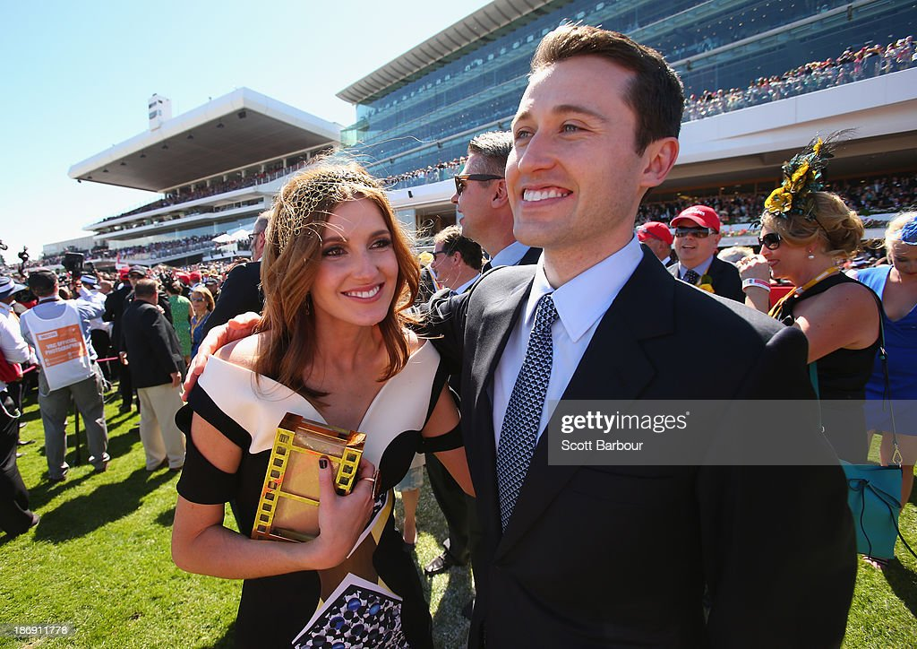 Tom Waterhouse and Kate Waterhouse celebrate after the Gai Waterhouse trained horse Fiorente wins the Melbourne Cup during Melbourne Cup Day at Flemington Racecourse on November 5, 2013 in Melbourne, Australia.