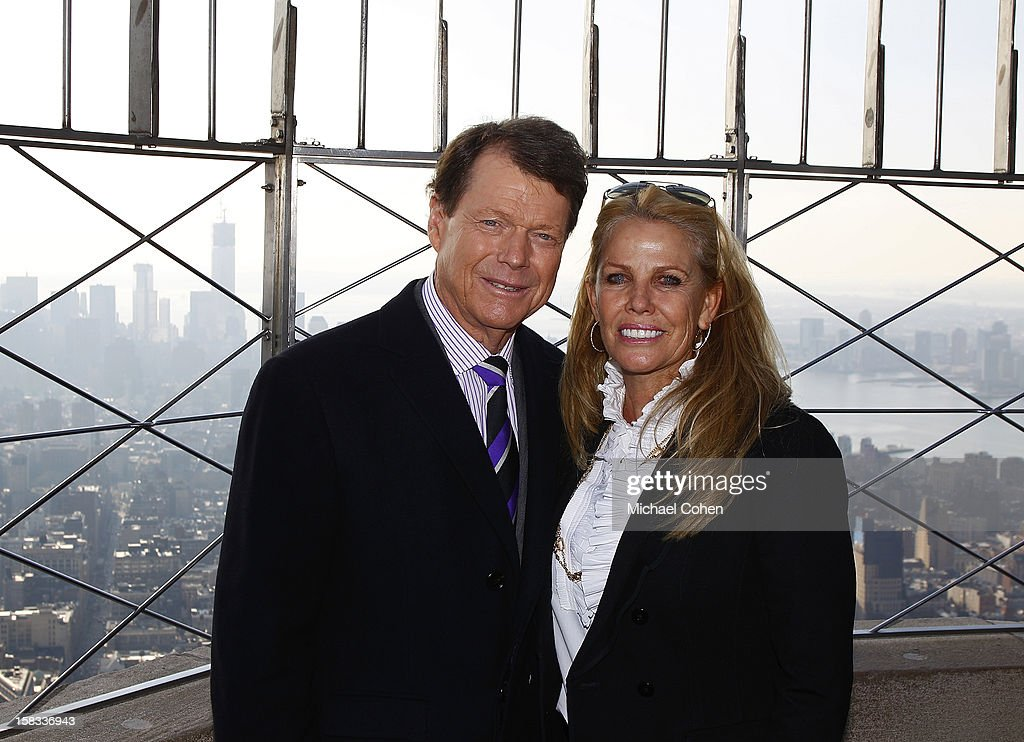 Tom Watson (L) and Hilary Watson stand on the Observatory level Empire State Building after the 2014 U.S. Ryder Cup Captain's News Conference held at the Empire State Building on December 13, 2012 in New York City.