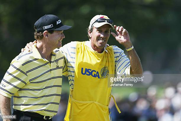 Tom Watson and his caddie Bruce Edwards walk off the 18th green during the final round of the 2003 US Open on the North Course at the Olympia Fields...