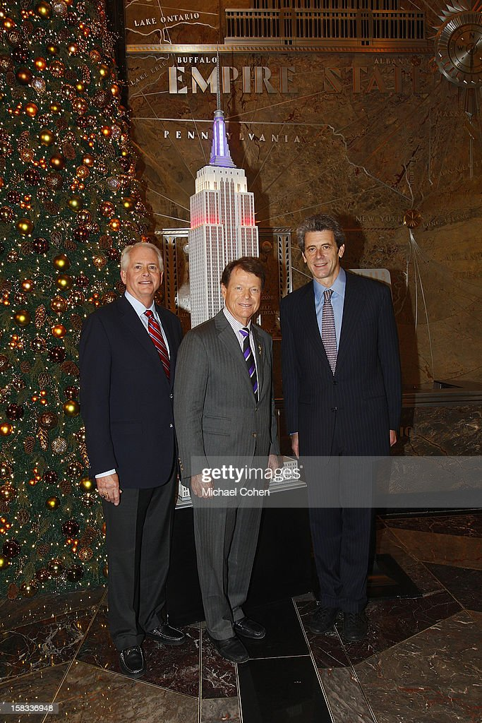 Tom Watson,(C) Harold Mieriam (L) and Anthony Malkin appear at a lighting ceremony after the 2014 U.S. Ryder Cup Captain's News Conference held at the Empire State Building on December 13, 2012 in New York City.