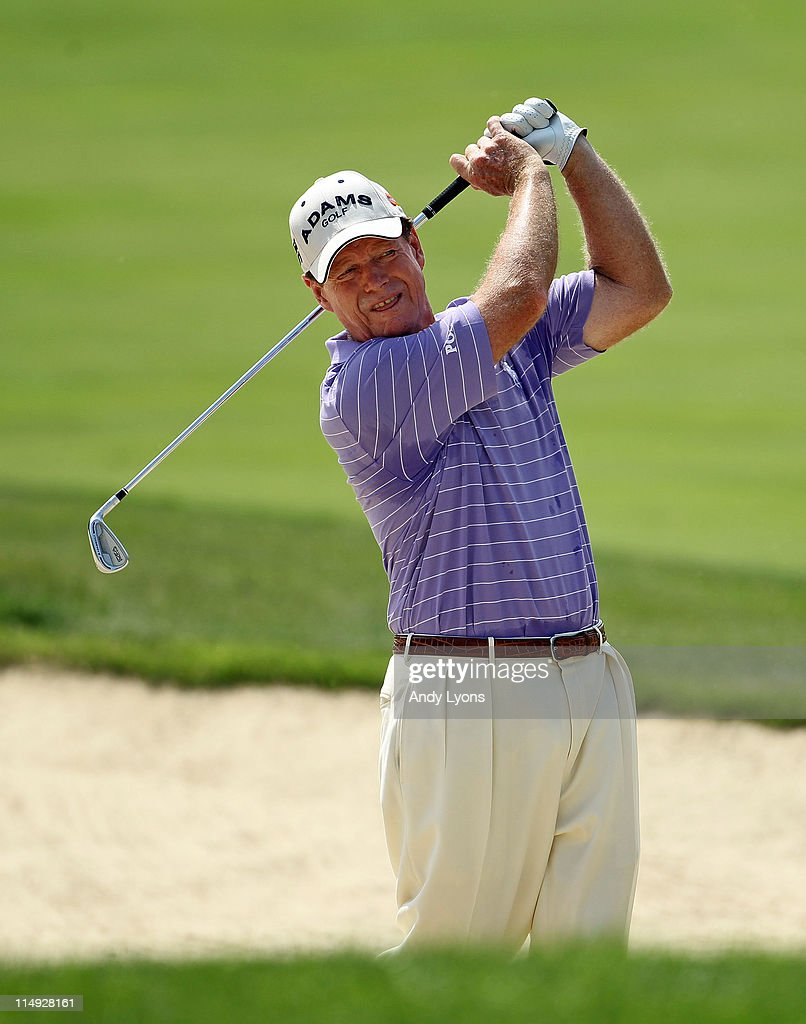 Tom Watson hits his second shot on the par 5 10th hole during the Senior PGA Championship presented by KitchenAid at Valhalla Golf Club on May 29, 2011 in Louisville, Kentucky. He won in a one hole playoff over David Eger .