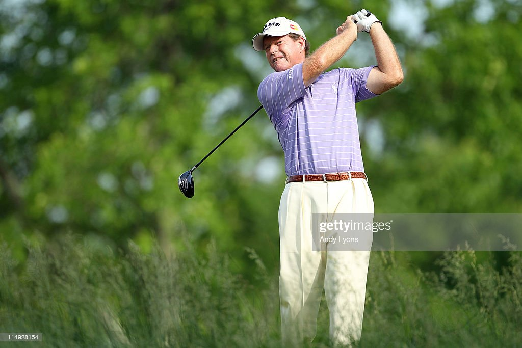 Tom Watson hits his tee shot on the par 5 18th hole during the Senior PGA Championship presented by KitchenAid at Valhalla Golf Club on May 29, 2011 in Louisville, Kentucky. He won in a one hole playoff over David Eger .