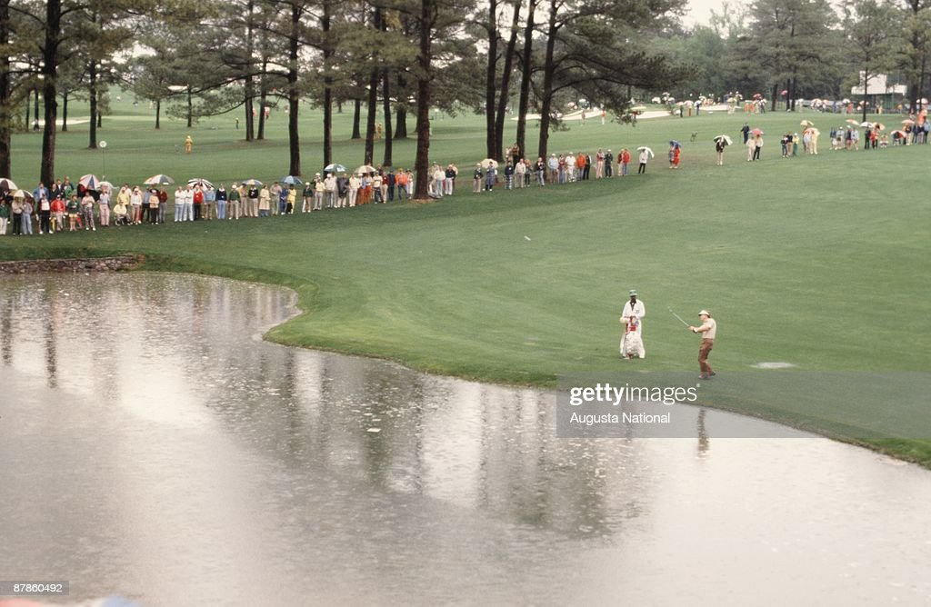 Tom Watson hits over the water hazard on the 15th hole during the 1979 Masters Tournament at Augusta National Golf Club on April 15th, 1979 in Augusta, Georgia.