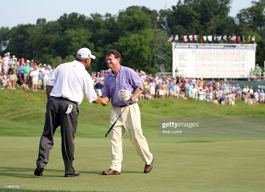 Tom Watson is congratulated by David Eger after Watson won the Senior PGA Championship presented by KitchenAid in a one hole playoff at Valhalla Golf Club on May 29, 2011 in Louisville, Kentucky.