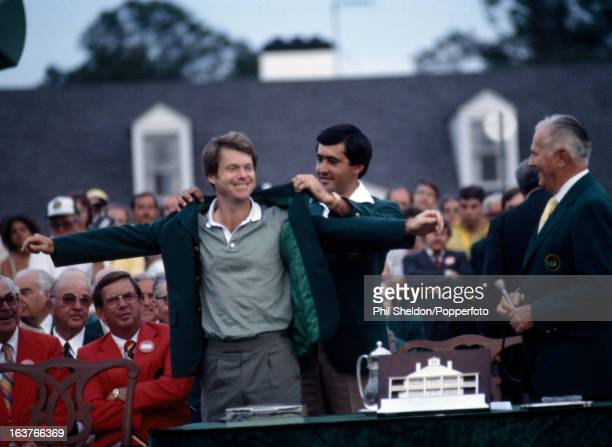 Tom Watson of the United States is presented his Green Jacket by the previous year's winner Seve Ballesteros of Spain after winning the US Masters...