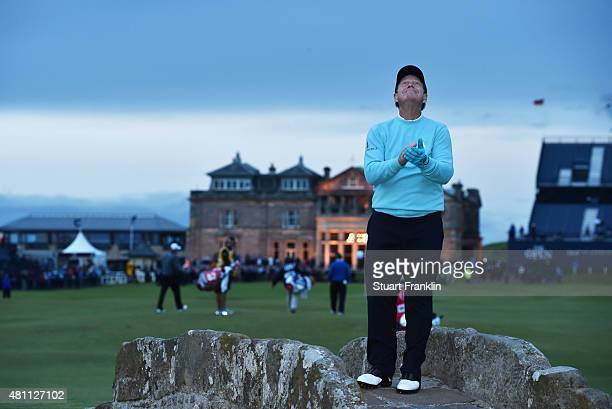 Tom Watson of the United States looks to the sky as he stands on Swilcan Bridge in honor of his final Open Championship appearance during the second...