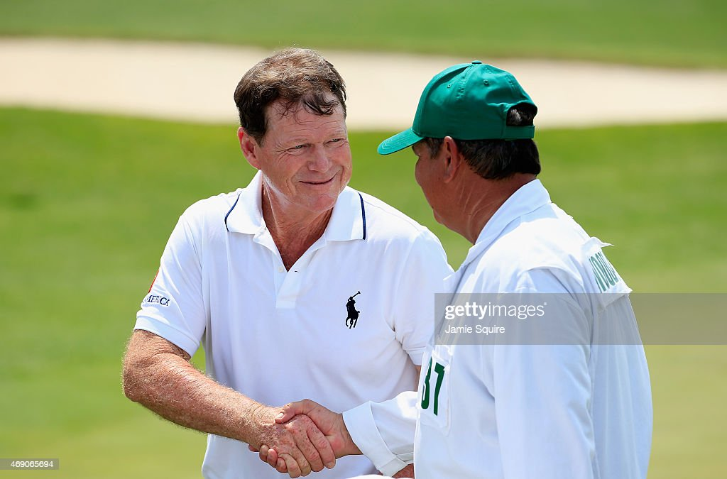 Tom Watson of the United States (L) shakes hands with caddie Tony Navarro during the first round of the 2015 Masters Tournament at Augusta National Golf Club on April 9, 2015 in Augusta, Georgia.