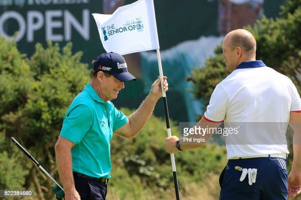Tom Watson of the United States shares a joke with Mike Tindall during the ProAm ahead of The Senior Tour Open Championship played at Royal Porthcawl...