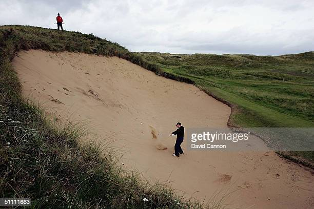 Tom Watson of the USA plays his second shot from the huge bunker 'Big Bertha' at the 17th hole during the third round of the Senior British Open on...