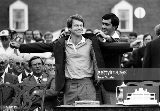 Tom Watson of the USA receives the Green Jacket from the 1980 champion Severiano Ballesteros of Spain during the 1981 Masters Tournament at Augusta...