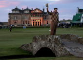 Tom Watson of the USA waves to the crowd on the Swilken Bridge on the 18th hole during the second round of the 139th Open Championship on the Old...