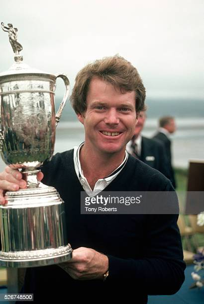 Tom Watson smiles as he holds the trophy he won at the 1982 US Open Golf Tournament