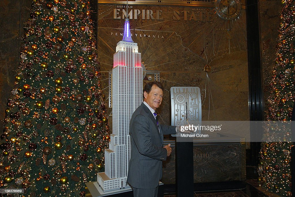 Tom Watson throws the swithch for the lights honoring the United States Ryder Cup on a replica of the EmpireState Building after the 2014 U.S. Ryder Cup Captain's News Conference held at the Empire State Building on December 13, 2012 in New York City.
