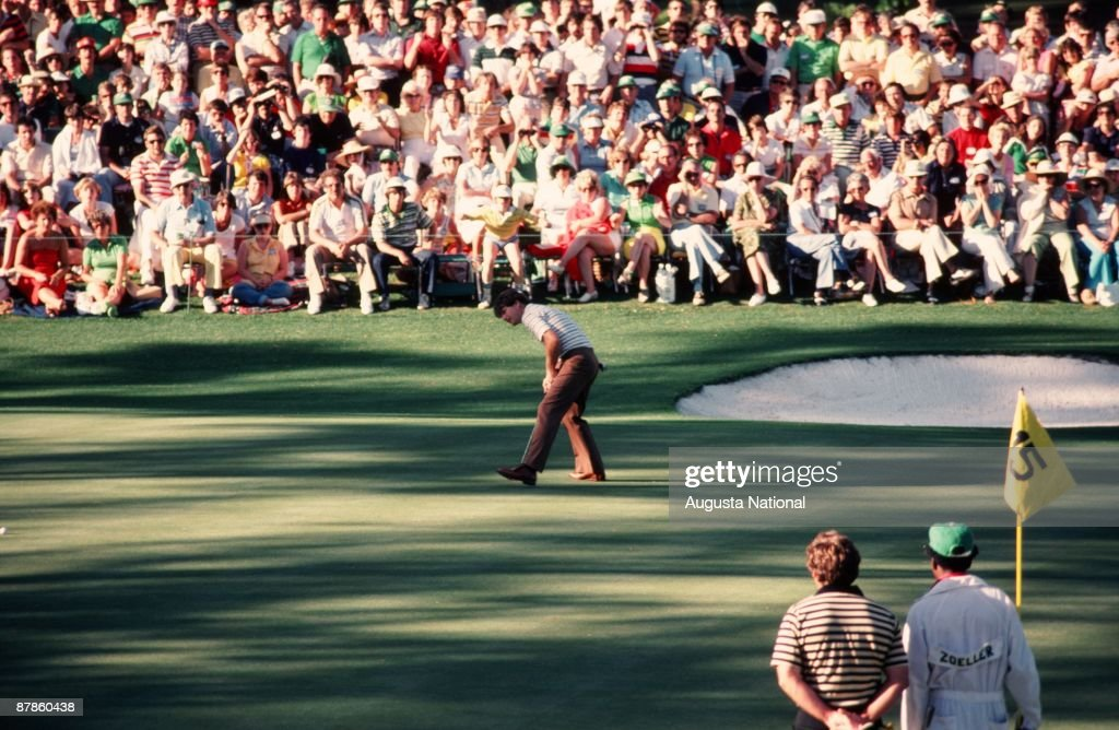 Tom Watson watches his putt on the 15th green in front of Fuzzy Zoeller and a large gallery during the 1979 Masters Tournament at Augusta National Golf Club on April 15th, 1979 in Augusta, Georgia.