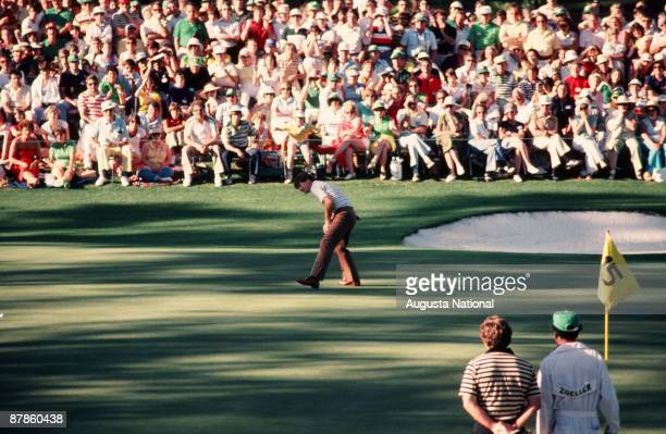 Tom Watson watches his putt on the 15th green in front of Fuzzy Zoeller and a large gallery during the 1979 Masters Tournament at Augusta National...