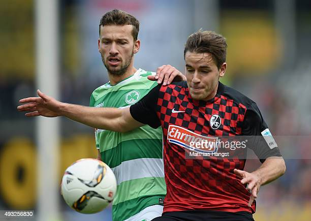 Tom Weilandt of Fuerth and Christian Guenter of Freiburg compete for the ball during the Second Bundesliga match between SC Freiburg and SpVgg...