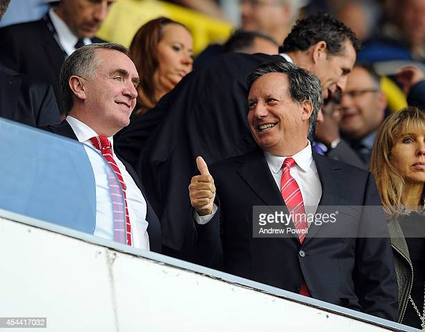 Tom Werner part owner of Liverpool with Ian Ayre managing director of Liverpool watch from the stands during the Barclays Premier League match...