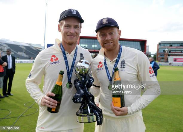 Tom Westley and Jonathan Bairstow of England celebrate with the series trophy after winning the Investec Test series between England and South Africa...