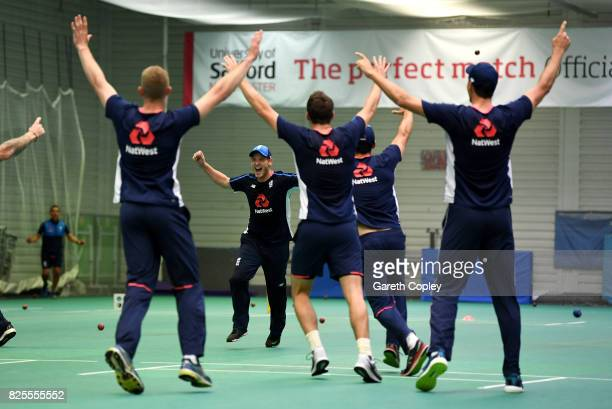 Tom Westley of England celebrates with teammates after winning a point in a fielding drill during a nets session at Old Trafford on August 2 2017 in...