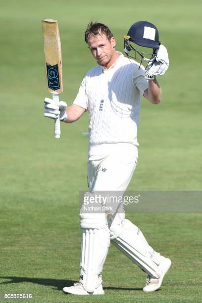 Tom Westley of England Lions raises his bat after scoring a hundred during the tour match between England Lions and South Africa A at New Road on...