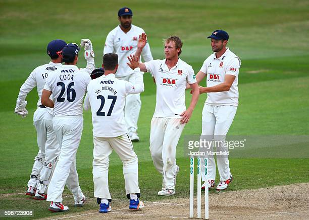 Tom Westley of Essex celebrates with his teammates after bowling out Ross Whiteley of Worcestershire during day three of the Specsavers County...