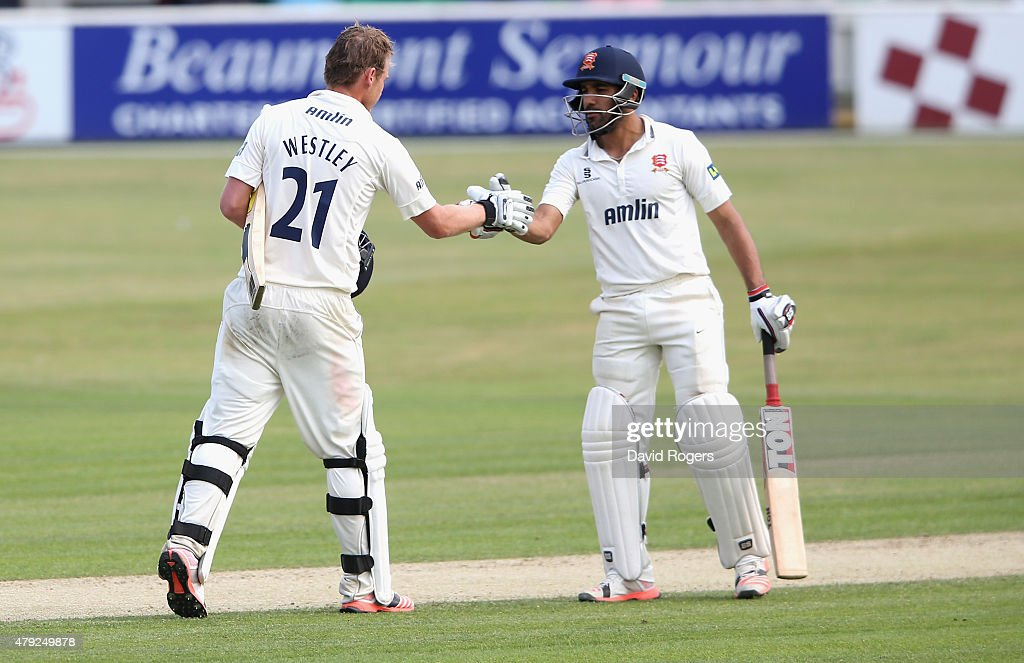 Tom Westley of Essex is congratulated by team mate Ravi Bopara after scoring a century during day two of the tour match between Essex and Australia...