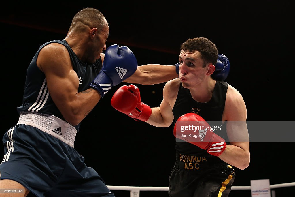 Tom Whitaker-Hart(red gloves) in action against Lynden Arthur in their 81kg final bout during day three of the Boxing Elite National Championships at Echo Arena on May 01, 2016 in Liverpool, England.