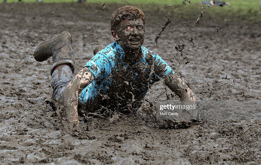 Tom Wilder, 17 from Kent, dives in the mud at the Glastonbury Festival site at Worthy Farm, Pilton on June 23, 2011 in Glastonbury, England. Music fans had to brave more rain today at the five-day festival which opened yesterday. This year the festival will feature headline acts U2, Coldplay and Beyonce. The festival, which started in 1970 when several hundred hippies paid 1 GBP to watch Marc Bolan, has grown into Europe's largest music festival attracting more than 175,000 people over five days.