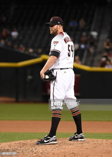 Tom Wilhelmsen of the Arizona Diamondbacks gets ready to deliver a pitch against the San Francisco Giants at Chase Field on April 5 2017 in Phoenix...
