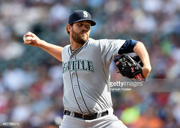Tom Wilhelmsen of the Seattle Mariners delivers a pitch against the Minnesota Twins during the eleventh inning of the game on August 2 2015 at Target...
