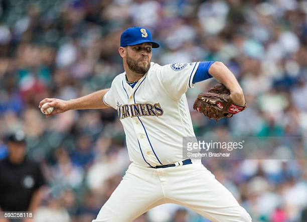 Tom Wilhelmsen of the Seattle Mariners delivers a pitch during the ninth inning of a game against the Milwaukee Brewers at Safeco Field on August 21...