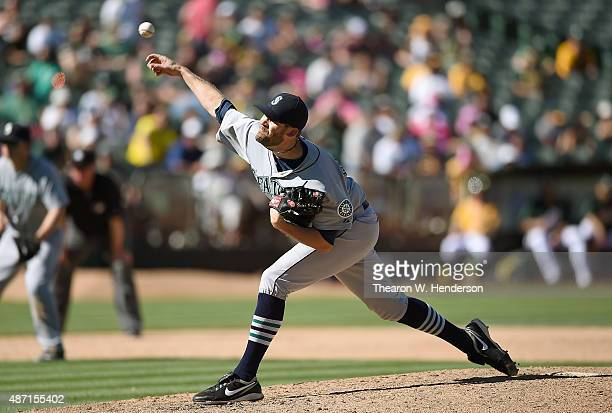 Tom Wilhelmsen of the Seattle Mariners pitches against the Oakland Athletics in the ninth inning at Oco Coliseum on September 6 2015 in Oakland...