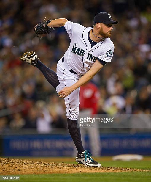 Tom Wilhelmsen of the Seattle Mariners pitches during MLB baseball action against the Washington Nationals at Safeco Field on August 30 2014 in...