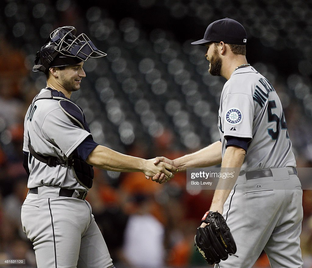 Tom Wilhelmsen #54 of the Seattle Mariners shakes hands with catcher Mike Zunino #3 of the Seattle Mariners after the final out against the Houston Astros at Minute Maid Park on June 30, 2014 in Houston, Texas.