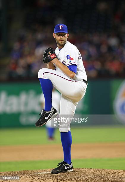 Tom Wilhelmsen of the Texas Rangers throws in the eighth inning against Seattle Mariners at Global Life Park in Arlington on April 5 2016 in...