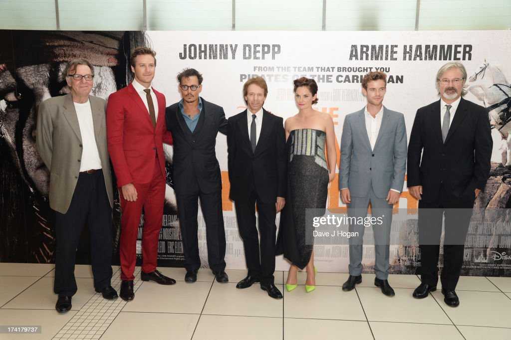 Tom Wilkinson, Armie Hammer, Johnny Depp, Jerry Bruckheimer, Ruth Wilson, Harry Threadaway and Gore Verbinski attend the UK premiere of 'The Lone Ranger' at The Odeon Leicester Square on July 21, 2013 in London, England.