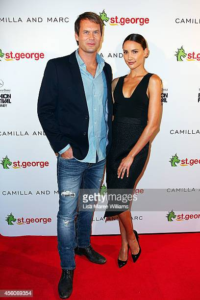 Tom Williams and Rachael Finch arrive for the Camilla and Marc St George show during MercedesBenz Fashion Festival Sydney at Sydney Town Hall on...