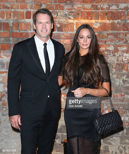 Tom Williams and Rachel Gilbert arrive at the Neiman Marcus dinner at The Mint on October 27 2014 in Sydney Australia
