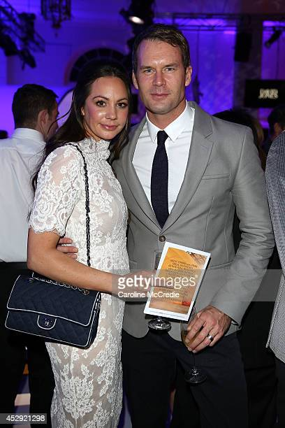 Tom Williams and Rachel Gilbert pose after the David Jones Spring/Summer 2014 Collection Launch at David Jones Elizabeth Street Store on July 30 2014...