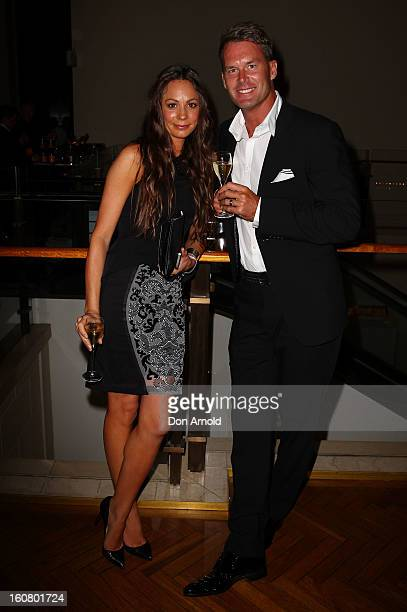 Tom Williams and Rachel Gilbert pose at the post show drinks during the David Jones A/W 2013 Season Launch at David Jones Castlereagh Street on...
