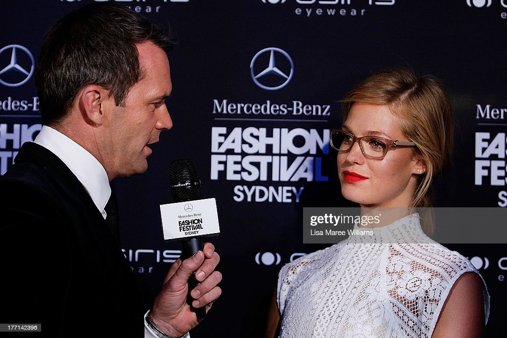 Tom Williams interviews Erin Heatherton at the MBFWA Trends show during Mercedes-Benz Fashion Festival Sydney 2013 at Sydney Town Hall on August 21, 2013 in Sydney, Australia.