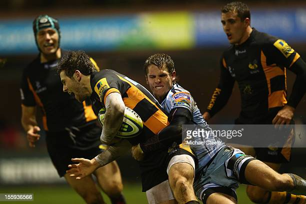 Tom Williams of Cardiff Blues tackles Elliot Daly of London Wasps during the LV Cup Pool match between Cardiff Blues and London Wasps at Cardiff Arms...