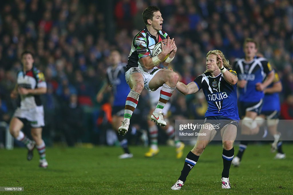 Tom Williams (C) of Harlequins gathers a high ball ahead of Tom Biggs (R) of Bath during the Aviva Premiership match between Bath and Harlequins at the Recreation Ground on November 23, 2012 in Bath, England.