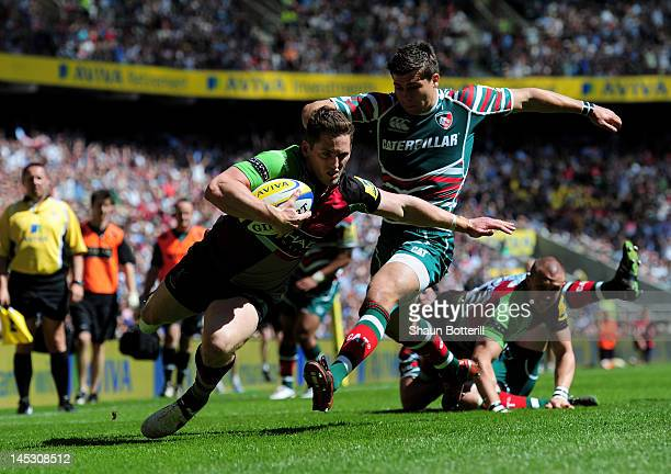 Tom Williams of Harlequins goes past the challenge from Ben Youngs of Leicester to score the opening try during the Aviva Premiership final between...