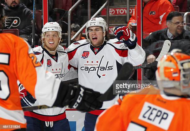 Tom Wilson and John Carlson of the Washington Capitals celebrate Wilson's second period goal against the Philadelphia Flyers on February 22 2015 at...