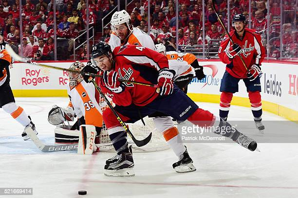 Tom Wilson of the Washington Capitals and Brandon Manning of the Philadelphia Flyers battle for the puck in the third period in Game Two of the...