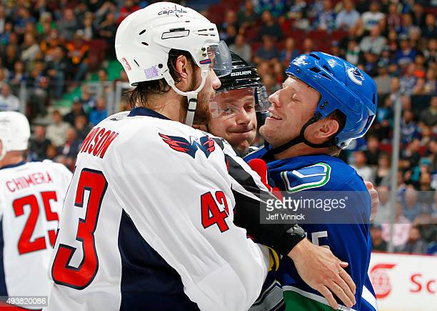 Tom Wilson of the Washington Capitals and Derek Dorsett of the Vancouver Canucks exchange greetings during their NHL game at Rogers Arena October 22...