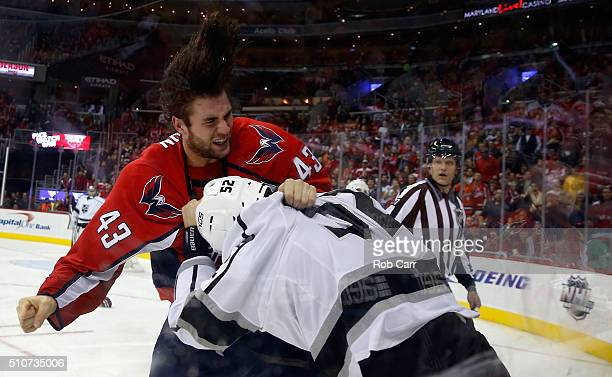 Tom Wilson of the Washington Capitals and Luke Schenn of the Los Angeles Kings fight in the second period at Verizon Center on February 16 2016 in...